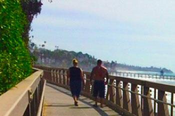 people walking on a boardwalk
